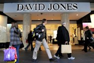 This file photo shows people walking past the flagship store of Australian retailing giant David Jones, in Melbourne, in 2011. Australia's corporate watchdog launched an investigation on Tuesday into a failed bid for David Jones from a mystery British company that reportedly operates out of a post office box