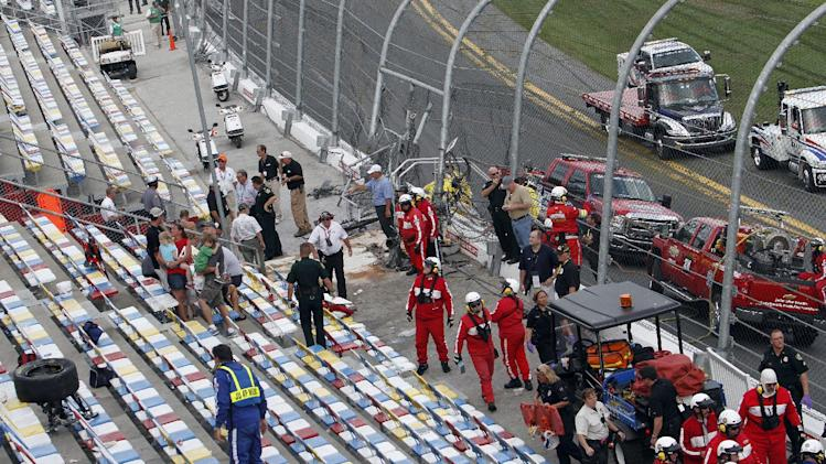 A tire from a car lies in the seats after a crash at the conclusion of the NASCAR Nationwide Series auto race Saturday, Feb. 23, 2013, at Daytona International Speedway in Daytona Beach, Fla. Kyle Larson's car hit the catch fence during the wreck. (AP Photo/David Graham)