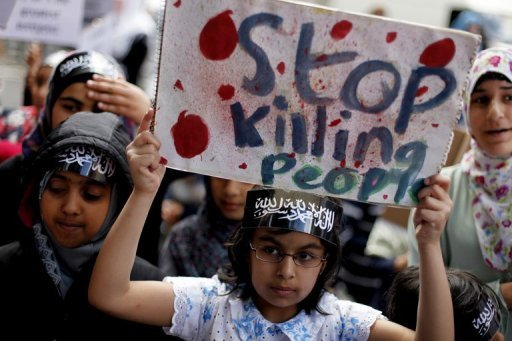 <p>A protester rallies against the Syrian regime outside its embassy in London on June 16. Britain has refused to grant the head of the Syrian Olympic Committee a visa to travel to London for the Games, the BBC reported on Friday.</p>