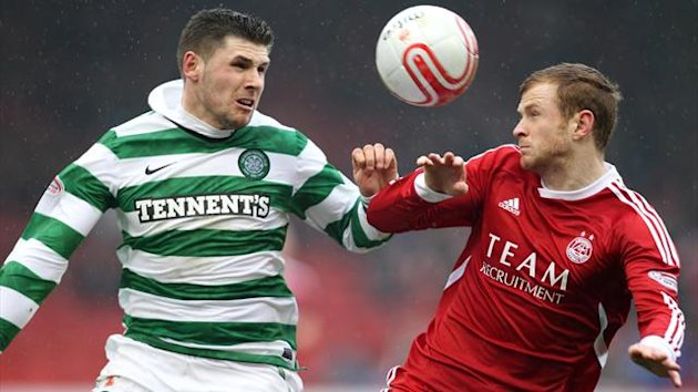 Mark Reynolds, right, has completed a permanent move to Aberdeen