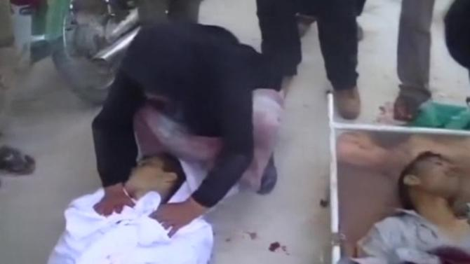 GRAPHIC IMAGES Assad forces kill 15 in Sunni village - activists