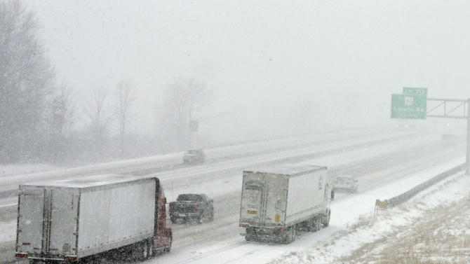 A truck parks on the side of the Ohio Turnpike in North Ridgeville, Ohio during the start of a major winter storm Wednesday, Dec. 26, 2012. The National Weather Service posted blizzard warnings for a swath of Ohio from the Indiana border stretching northeast to the Lake Erie region. (AP Photo/Mark Duncan)