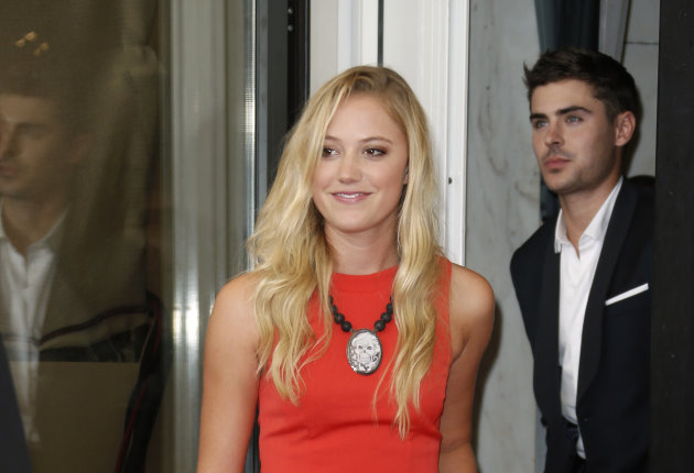 Actors Zac Efron, right, and Maika Monroe pose at the photo call for the film 'At Any Price' during the 69th edition of the Venice Film Festival in Venice, Italy, Friday, Aug. 31, 2012. (AP Photo/Joel Ryan)