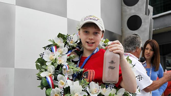 "IMAGE DISTRIBUTED FOR HOT WHEELS - Christopher Bienusa, 12-year-old from Alexandria, Minn., celebrates winning the Hot Wheels ""World's Best Driver Championship"" in traditional Indy 500 fashion on Saturday, May 25, 2013, at the Indianapolis Motor Speedway. Coached by racing legends Mario and John Andretti, Bienusa's toy-sized car finished first on the world record-setting one mile-long iconic Hot Wheels orange toy track.(Photo by Phil Abbott/Invision for Hot Wheels/AP Images)"