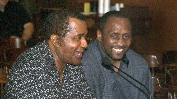 "FILE-This May 26, 2004 file photo shows  president of the Kronk Gym Emanuel Steward, left, sharing a laugh with Tommy ""Hitman"" Hearns during  testimony on legislation to reform the boxing industry at the Michigan State Capitol in Lansing, Mich. Steward, the owner of the legendary Kronk Gym and one of boxing's greatest trainers, has died. He was 68. Victoria Kirton, Steward's executive assistant, says Steward died Thursday Oct. 25, 2012 in a Chicago hospital. She did not disclose the cause of death.  (AP Photo/Daymon J. Hartley, File)"