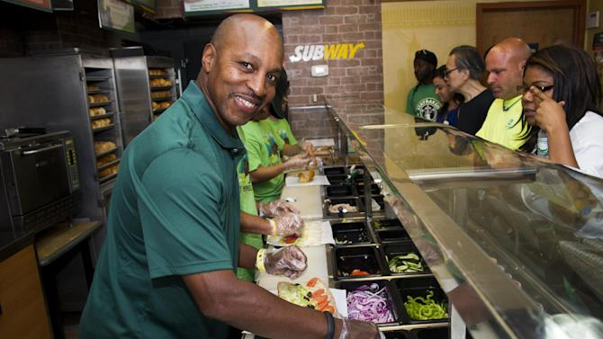 IMAGE DISTRIBUTED FOR SUBWAY - Baseball all-star Willie Randolph makes sandwiches for fans and gives out the new limited edition SUBWAY bag that encourages healthier lifestyles on Tuesday, July 16, 2013 in New York. (Photo by Charles Sykes/Invision for SUBWAY/AP Images)