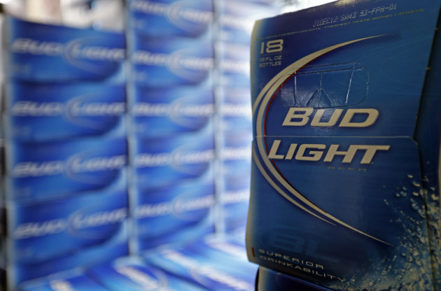 <p>               FILE - In this Monday, Jan. 28, 2013, file photo, Bud Light beer is shown in the aisles of Elite Beverages in Indianapolis. Beer lovers across the country have filed $5 million class-action lawsuits accusing Anheuser-Busch of watering down its Budweiser, Michelob and other brands.  (AP Photo/Michael Conroy, File)