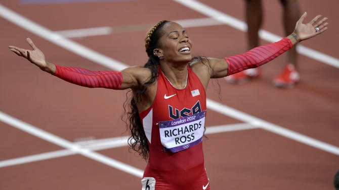 United States' Sanya Richards-Ross celebrates her win in the women's 400-meter final during the athletics in the Olympic Stadium at the 2012 Summer Olympics, London, Sunday, Aug. 5, 2012. (AP Photo/Martin Meissner)
