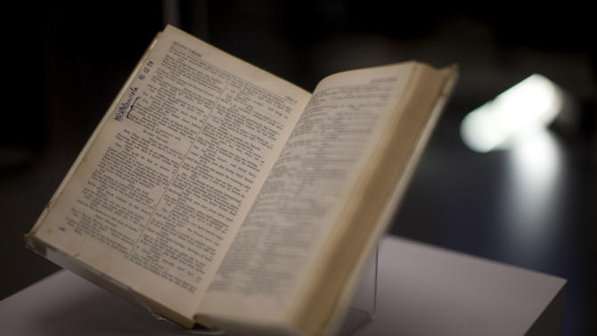 """A copy of the """"Complete Works of Shakespeare"""" is displayed and signed by Nelson Mandela and owned by Sonny Venkatrathnam, who was imprisoned on Robben Island in South Africa, during the press view of the """"Shakespeare: staging the world"""" exhibition at the British Museum in London, Wednesday, July 18, 2012. The exhibition, which is being held as part of the London 2012 cultural Olympiad, provides a unique insight into the emerging role of London as a world city 400 years ago, seen through the innovative perspective of Shakespeare's plays.  It runs from July 19 to November 25. (AP Photo/Matt Dunham)"""