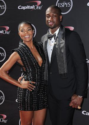 FILE - In this July 17, 2013, Actress Gabrielle Union, left, and Miami Heat's Dwyane Wade arrive at the ESPY Awards in Los Angeles. Wade and Union are engaged. The Miami Heat star proposed to his longtime girlfriend Saturday, Dec. 21, 2013, and the actress accepted. They announced the news through social media, around the same time as the two-time defending NBA champions were gathering for a team Christmas party. (Photo by Jordan Strauss/Invision/AP, File)