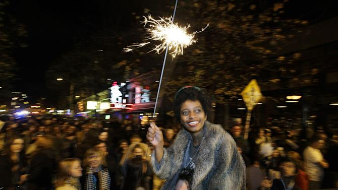 Crystal Davis, of Seattle, waves a sparkler as she celebrates the 2012 election with a large crowd in Seattle's Capitol Hill neighborhood, Tuesday, Nov. 6, 2012, in Seattle's Capitol Hill neighborhood. The re-election of President Barack Obama and Washington state's referendum 74, which would legalize gay marriage, drew the most supporters to the streets. (AP Photo/Ted S. Warren)