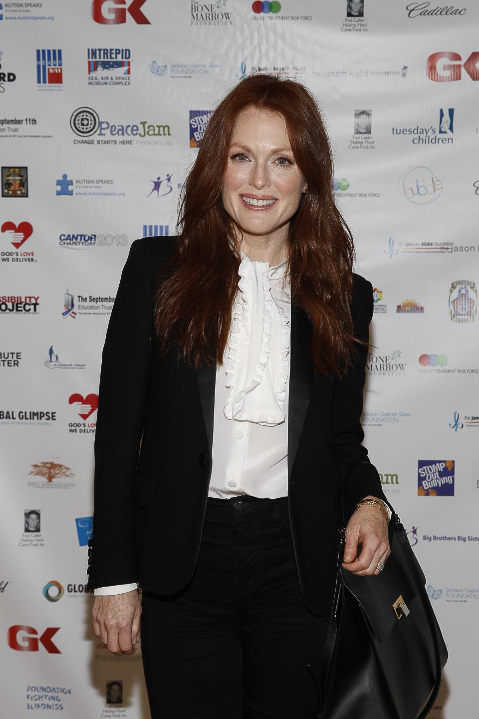 Julianne Moore arrives at the Annual Charity Day hosted by Cantor Fitzgerald and BGC Partners, on Wednesday, Sept. 11, 2013, in New York. (Photo by Mark Von Holden/Invision/AP)