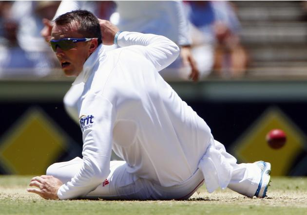 England's Swann dives to try and stop a shot by Australia's David Warner during the first day of the third Ashes cricket test at the WACA ground in Perth
