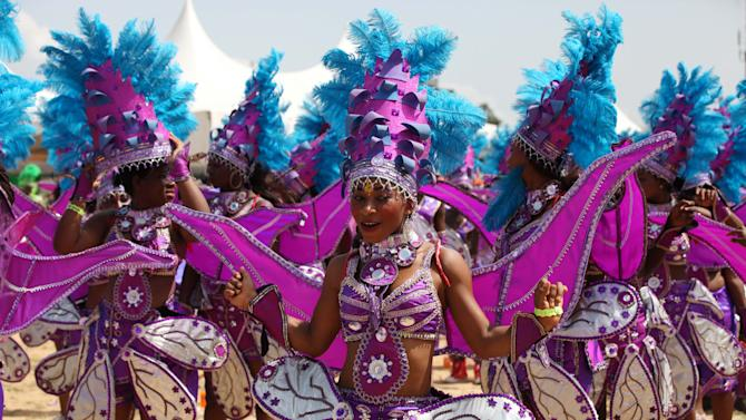 Performers dance during Lagos Carnival in Lagos, Nigeria,  Monday, April 1, 2013. Performers filled the streets of Lagos' islands Monday as part of the Lagos Carnival, a major festival in Nigeria's largest city during Easter weekend. (AP Photo/Sunday Alamba)