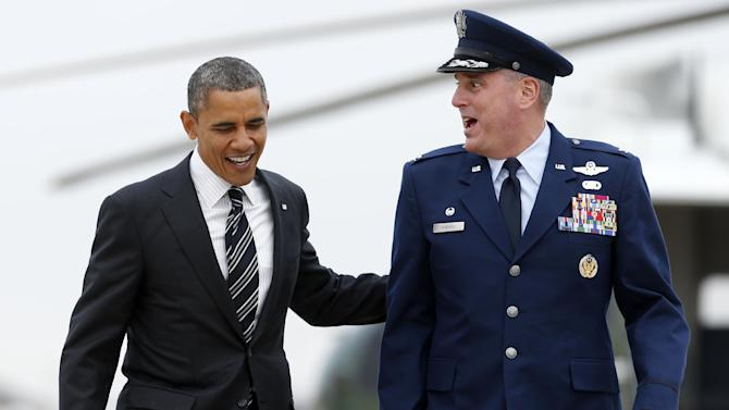 President Barack Obama walks from Marine One with Col. Michael Minihan to board Air Force One, Thursday, Nov. 15, 2012, at Andrews Air Force Base, Md., en route to New York to visit areas devastated by Superstorm Sandy. (AP Photo/Carolyn Kaster)