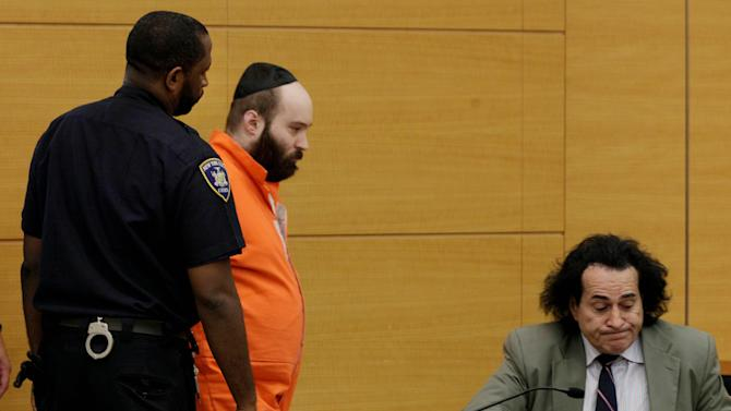 Levi Aron, center, with his attorney Howard Greenberg, is escorted by a court officer to plead in New York state Supreme Court, in New York's Brooklyn borough, Thursday, Aug. 9, 2012. Aron pleaded guilty to charges he abducted and dismembered Leiby Kletzky, an 8-year-old boy who became lost in Brooklyn after leaving a day camp. It will result in a sentence of 40 years to life in prison. (AP Photo/Richard Drew, Pool)