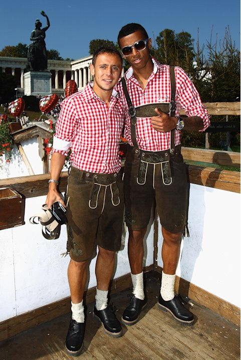 Bayern Munich  Brazilian players Rafinho, left, and Luiz Gustavo  enjoy the Oktoberfest beer festival  on the balcony of a tent in Munich, Germany, Sunday Oct.2, 2011. (AP Photo/ Alexander Hassenstein
