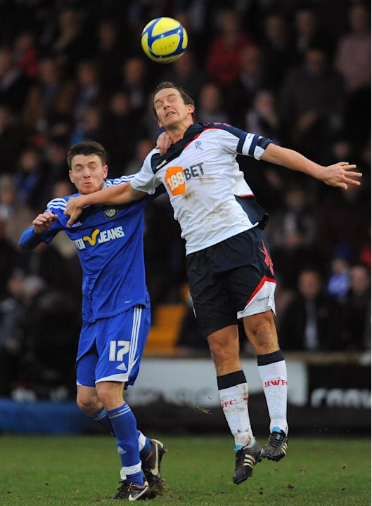 Macclesfield Town's English midfielder Sam Wedgbury (L) vies with Bolton Wanderers' English forward Kevin Davies during the FA Cup football match between Macclesfield Town and Bolton Wanderers at Moss