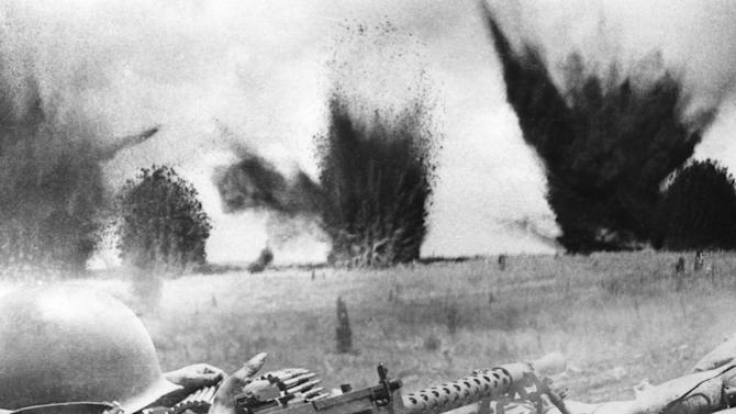 FILE - U.S. Air Force bombs create a curtain of flying shrapnel and debris barely 200 feet beyond the perimeter of South Vietnamese ranger positions defending Khe Sanh during the siege of the U.S. Marine base, March 1968. (AP Photo/ARVN, Maj. Nguyen Ngoc Hanh, File)