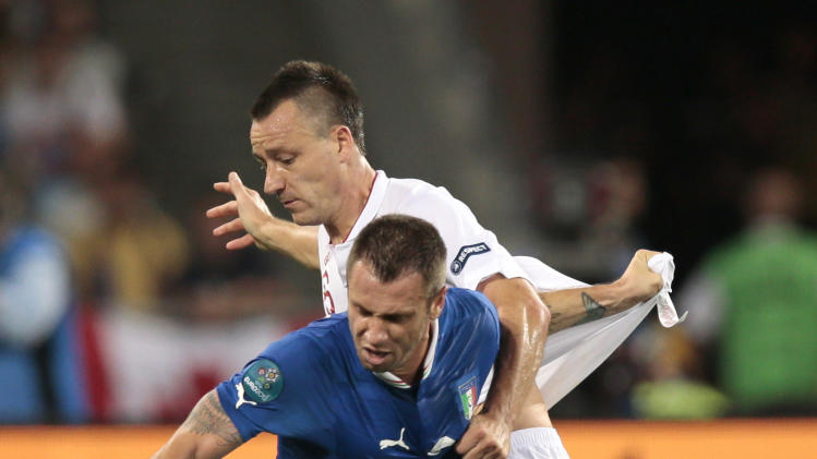 Italy's Antonio Cassano, foreground, and England's John Terry challenge for the ball  during the Euro 2012 soccer championship quarterfinal match between England and Italy in Kiev, Ukraine, Sunday, June 24, 2012. (AP Photo/Ivan Sekretarev)