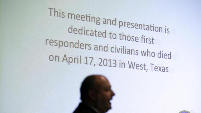 State Fire Marshal Chris Connealy stands in front of a large projections screen as he addresses a group of over 100 first responders, business owners and operators, Thursday, Dec. 12, 2013, in Clifton, Texas. When a fertilizer plant exploded in a small Texas town, killing 15 people and decimating homes and schools, it became Connealy's responsibility to stop anything like it from happening again. (AP Photo/Tony Gutierrez)