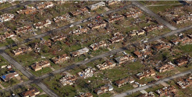 FILE - This May 24, 2011 aerial file photo shows a neighborhood destroyed by a powerful tornado in Joplin, Mo. Some federal money pledged to tornado-ravaged Joplin and other disaster sites is being di