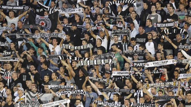 Supporters of Partizan Belgrade cheer their team during their Europa League Group C soccer match against Tottenham Hotspur in Belgrade