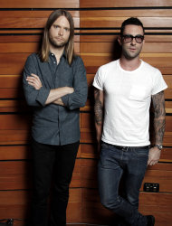 "This May 22, 2012 photo shows Adam Levine, right, and James Valentine of the band Maroon 5, posing for a portrait in Los Angeles. The latest release by Maroon 5, ""Overexposed,"" was released on Tuesday, June 26. (Photo by Matt Sayles/Invision/AP)"
