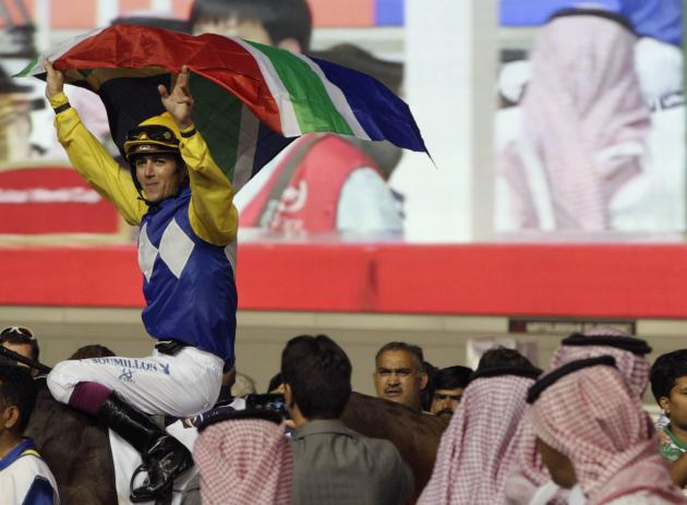 "Soumillon, riding Shea Shea of South Africa, celebrates after winning the fifth race ""Al Quoz Sprint"" during the Dubai World Cup at the Meydan Racecourse in Duba"