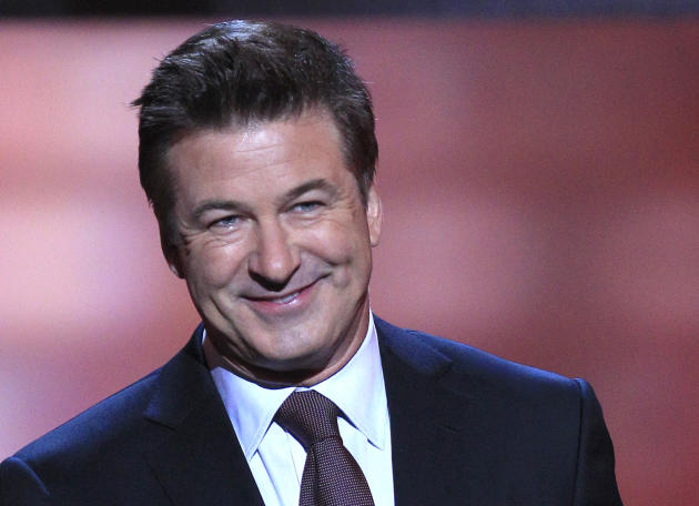 FILE - In this Feb. 4, 2012 file photo, host Alec Baldwin speaks during the inaugural NFL Honors show in Indianapolis. Just days after tying the knot with his yoga instructor, Baldwin donated $1 milli