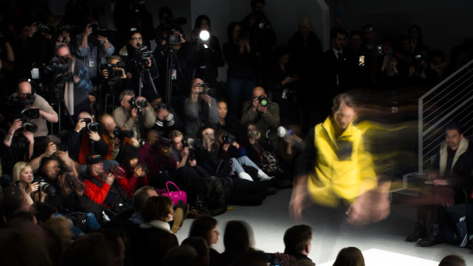 In this photo made with a long exposure, a model walks the runway during the Nautica Fall 2013 fashion show at the Mercedes-Benz Fashion Week tents at Lincoln Center, Friday, Feb. 8, 2013, in New York. (AP Photo/John Minchillo)