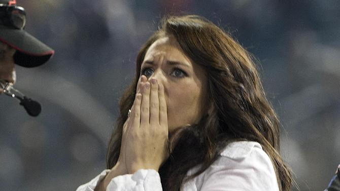 Haley Carey, Ty Dillon's girlfriend, reacts as Dillon wrecks during the final laps of the NASCAR Nationwide Truck Series auto race on Friday, Nov. 16 2012, at Homestead-Miami Speedway in Homestead, Fla. (AP Photo/J Pat Carter)