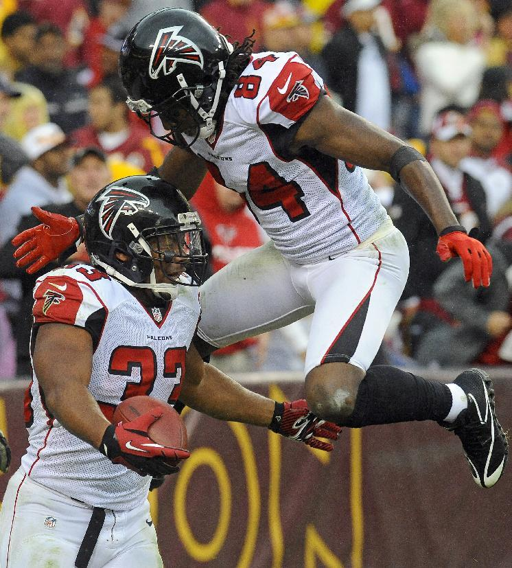 Atlanta Falcons running back Michael Turner (33) celebrates his touchdown with teammate wide receiver Roddy White (84) during the second half of an NFL football game against the Washington Redskins in Landover, Md., Sunday, Oct. 7, 2012. (AP Photo/Richard Lipski)