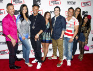 "FILE - This Oct. 24, 2012 photo shows ""Jersey Shore"" cast members, from left, Mike ""The Situation"" Sorrentino, Jenni ""JWoww"" Farley, Paul ""Pauly D"" Delvecchio, Deena Cortese, Vinny Guadagnino, Ronnie Ortiz-Magro, Sammi ""Sweetheart"" Giancola and Nicole ""Snooki"" Polizzi at a panel entitled ""Love, Loss, (Gym, Tan) and Laundry: A Farewell to the Jersey Shore"" in New York. Seaside Heights, the New Jersey town that for millions made ""Jersey Shore"" synonymous with Snooki was among the hardest hit by Superstorm Sandy and its famous summer residents sent their prayers to those affected. Farley, DelVecchio, Guadagnino asked their Twitter followers to donate to the American Red Cross. Polizzi also said she would donate. (Photo by Charles Sykes/Invision/AP)"