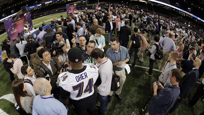 Baltimore Ravens offensive lineman Michael Oher answers questions during media day for the NFL Super Bowl XLVII football game Tuesday, Jan. 29, 2013, in New Orleans. (AP Photo/Charlie Riedel)