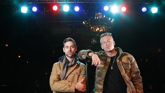 """FILE - In this Nov. 20, 2012 file photo, American musician Ben Haggerty, better known by his stage name Macklemore (R), and his producer Ryan Lewis pose for a portrait at Irving Plaza in New York.  Macklemore & Ryan Lewis feat. Wanz, """"Thrift Shop"""" (Macklemore) is the number one top streamed track for the United States on Spotify from Monday, Jan. 28, to Sunday, Feb. 3, 2013. (Photo by Carlo Allegri/Invision/AP, File)"""