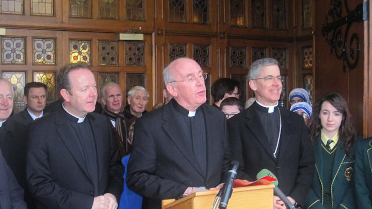 The Roman Catholic Church's much-criticized leader in Ireland Cardinal Sean Brady , centre,  announces his retirement, due in 2015, accompanied by Monsignor Eamon Martin (left), named as his successor, and Papal Nuncio Charles Brown (right) on the steps of Armagh Cathedral  Friday Jan 18 2013. (AP Photo/ David Young/PA) UNITED KINGDOM OUT  NO SALES  NO ARCHIVE