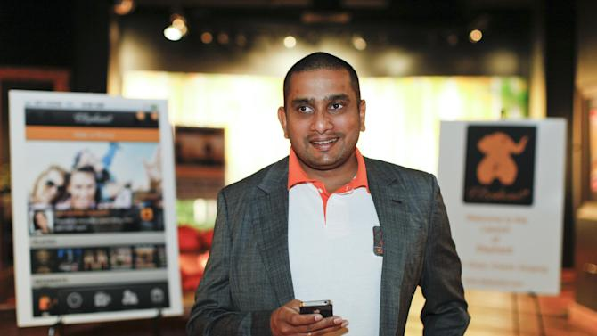 IMAGE DISTRIBUTED FOR ELEPHANTI - CEO Lalin Jinasena at the San Francisco launch of the new free social app, Elephanti, that connects customers with local merchants, lets them discover new ones, and gives them a guaranteed discount every time they make a purchase, on Thursday, Nov. 29, 2012 in San Francisco, Calif.  (Photo by Alison Yin/AP Images for Elephanti)