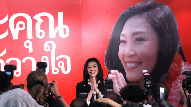Yingluck Shinawatra, opposition Pheu Thai Party's candidate for prime minister and youngest sister of ousted Prime Minister Thaksin Shinawatra, gestures as she attends a press conference at the party headquarters in Bangkok, Thailand, on Sunday, July 3, 2011. The apparent election result on Sunday paves the way for Yingluck Shinawatra to become Thailand's first female prime minister. (AP Photo/Vincent Yu)