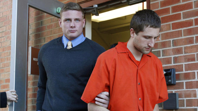 FILE - In this Nov. 13, 2012,  file photo, Micah Moore, 23, right, is escorted into the Jackson County Courthouse Annex in Independence, Mo., for his murder charge in the death of 27-year-old Bethany Ann Deaton. Moore is scheduled for a preliminary hearing on a first-degree murder charge Wednesday, Nov. 28, 2012. (AP Photo/The Kansas City Star, Keith Myers, File)