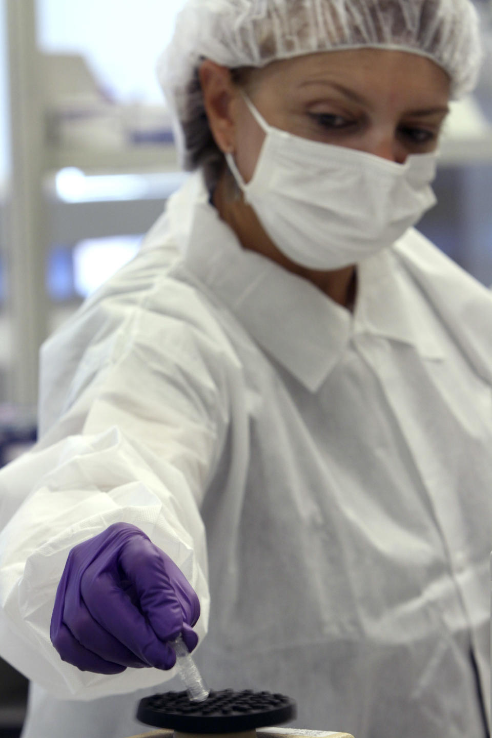 This Wednesday, Aug. 10 2011 photo shows Tatyana Gryazeva, right, a criminalist at the Office of Chief Medical Examiner, during an demonstration on extracting DNA at a training lab of the OCME Forensic Biology Lab in New York.  (AP Photo/Mary Altaffer)
