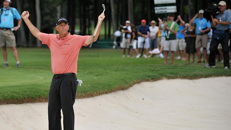 Tom Lehman celebrates his birdie on No. 9 to take the lead during the third round of the Champions Tour's Regions Tradition golf tournament, Saturday, June 9, 2012, at Shoal Creek in Birmingham, Ala. (AP Photo/The Birmingham News,Tamika Moore) MAGS OUT