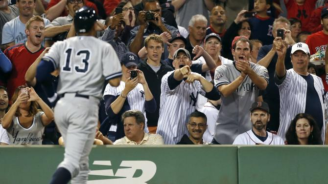 Fans react as New York Yankees' Alex Rodriguez (13) heads to the dug out after hitting a solo home run in the sixth inning of a baseball game against the Boston Red Sox, Sunday, Aug. 18, 2013, in Boston. (AP Photo/Michael Dwyer)