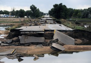 This photo shows flood damage to Old Highway 34 in…