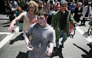 People dressed as zombies march around the streets of San Francisco to promote a new game for the iPhone in May 2012. The US Centers for Disease Control and Prevention (CDC) has declared there was no conclusive evidence for the existence of zombies. (AFP Photo/Kimihiro Hoshino)