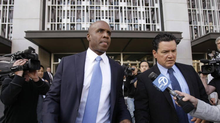 Former San Francisco Giants baseball player Barry Bonds leaves the federal courthouse in San Francisco after a hearing about his perjury trial, Thursday, June 23, 2011.  (AP Photo/Paul Sakuma)