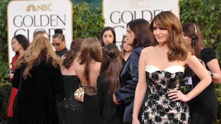 Actress Tina Fey arrives at the 70th Annual Golden Globe Awards at the Beverly Hilton Hotel on Sunday Jan. 13, 2013, in Beverly Hills, Calif. (Photo by John Shearer/Invision/AP)
