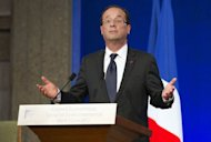 French President Francois Hollande, picture June 12, faced his first political storm as his rightwing opponents looked to exploit an incendiary tweet by his partner just days ahead of a parliamentary election.