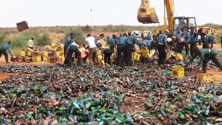 Sharia enforcers destroy thousands of bottles of beer outside northern Nigeria's largest city of Kano on November 27, 2013