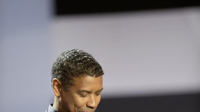 U.S. actor Denzel Washington receives a Donostia award for his film career from director Antoine Fuqua on the first day of the 62nd San Sebastian Film Festival